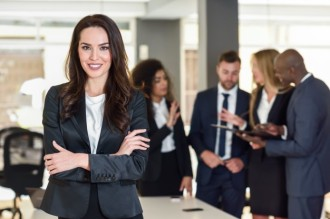businesswoman-leader-in-modern-office-with-businesspeople-workin_1139-954